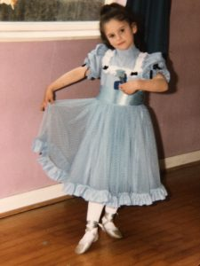 Gayle aged 6 dancing in blue dress